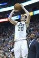 Mar 31, 2014; Salt Lake City, UT, USA; Utah Jazz guard Gordon Hayward (20) shoots during the second half against the New York Knicks at EnergySolutions Arena. The Knicks won 92-83. Mandatory Credit: Russ Isabella-USA TODAY Sports