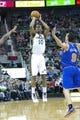 Mar 31, 2014; Salt Lake City, UT, USA; Utah Jazz guard Alec Burks (10) shoots during the second half against the New York Knicks at EnergySolutions Arena. The Knicks won 92-83. Mandatory Credit: Russ Isabella-USA TODAY Sports