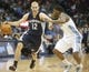 Mar 31, 2014; Denver, CO, USA; Memphis Grizzlies guard Nick Calathes (12) dribbles the ball during the second half against the Denver Nuggets at Pepsi Center.  The Grizzlies won 94-92.  Mandatory Credit: Chris Humphreys-USA TODAY Sports