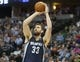 Mar 31, 2014; Denver, CO, USA; Memphis Grizzlies center Marc Gasol (33) shoots the ball during the second half against the Denver Nuggets at Pepsi Center.  The Grizzlies won 94-92.  Mandatory Credit: Chris Humphreys-USA TODAY Sports