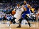 Apr 1, 2014; Dallas, TX, USA; Dallas Mavericks guard Monta Ellis (11) drives to the basket as Golden State Warriors forward Andre Iguodala (9) defends during the game at American Airlines Center. Golden State won 122-120. Mandatory Credit: Kevin Jairaj-USA TODAY Sports