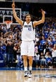 Apr 1, 2014; Dallas, TX, USA; Dallas Mavericks forward Dirk Nowitzki (41) reacts after scoring during the game against the Golden State Warriors at American Airlines Center. Golden State won 122-120. Mandatory Credit: Kevin Jairaj-USA TODAY Sports