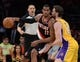 Apr 1, 2014; Los Angeles, CA, USA;  Los Angeles Lakers center Pau Gasol (16) guards Portland Trail Blazers forward LaMarcus Aldridge (12) during the second half of the game at Staples Center. Trail Blazers won 124-112. Mandatory Credit: Jayne Kamin-Oncea-USA TODAY Sports