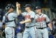 Apr 2, 2014; Milwaukee, WI, USA;   Atlanta Braves third baseman Chris Johnson (center) celebrates with catcher Gerald Laird (left) and pitcher Craig Kimbrel (right) after the Braves beat the Brewers 1-0 at Miller Park. Mandatory Credit: Benny Sieu-USA TODAY Sports