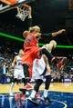 Apr 2, 2014; Atlanta, GA, USA; Chicago Bulls forward Taj Gibson (22) dunks over Atlanta Hawks center Pero Antic (6) in the first half at Philips Arena. Mandatory Credit: Daniel Shirey-USA TODAY Sports