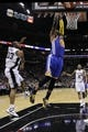 Apr 2, 2014; San Antonio, TX, USA; Golden State Warriors forward Marreese Speights (5) dunks the ball past San Antonio Spurs forward Boris Diaw (33) during the first half at AT&T Center. Mandatory Credit: Soobum Im-USA TODAY Sports
