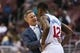 Apr 2, 2014; Philadelphia, PA, USA; Philadelphia 76ers head coach Brett Brown talks with forward James Nunnally (12) during the fourth quarter against the Charlotte Bobcats at the Wells Fargo Center. The Bobcats defeated the Sixers 123-93. Mandatory Credit: Howard Smith-USA TODAY Sports