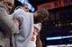 Apr 2, 2014; New York, NY, USA; New York Knicks guard Raymond Felton (2) is tended to by teammates and officials after an injury against the Brooklyn Nets during the second half at Madison Square Garden. The New York Knicks won 110-81. Mandatory Credit: Joe Camporeale-USA TODAY Sports