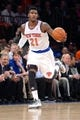 Apr 2, 2014; New York, NY, USA; New York Knicks guard Iman Shumpert (21) dribbles against the Brooklyn Nets during the second half at Madison Square Garden. The New York Knicks won 110-81. Mandatory Credit: Joe Camporeale-USA TODAY Sports