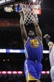 Apr 2, 2014; San Antonio, TX, USA; Golden State Warriors forward Draymond Green (23) dunks the ball against the San Antonio Spurs during the second half at AT&T Center. The Spurs won 111-90. Mandatory Credit: Soobum Im-USA TODAY Sports