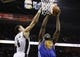 Apr 2, 2014; San Antonio, TX, USA; Golden State Warriors forward Draymond Green (23) drives to the basket as San Antonio Spurs guard Danny Green (4) defends during the second half at AT&T Center. The Spurs won 111-90. Mandatory Credit: Soobum Im-USA TODAY Sports
