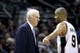 Apr 2, 2014; San Antonio, TX, USA; San Antonio Spurs guard Tony Parker (9) talks with head coach Gregg Popovich during the second half against the Golden State Warriors at AT&T Center. The Spurs won 111-90. Mandatory Credit: Soobum Im-USA TODAY Sports