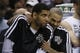 Apr 2, 2014; San Antonio, TX, USA; San Antonio Spurs forward Tim Duncan (left) and guard Tony Parker (right) share a laugh on the bench during the second half against the Golden State Warriors at AT&T Center. The Spurs won 111-90. Mandatory Credit: Soobum Im-USA TODAY Sports