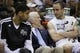 Apr 2, 2014; San Antonio, TX, USA; San Antonio Spurs guard Manu Ginobili (right), and head coach Gregg Popovich (center), and Tim Duncan (left) talk on the bench during the second half against the Golden State Warriors at AT&T Center. The Spurs won 111-90. Mandatory Credit: Soobum Im-USA TODAY Sports
