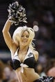 Apr 2, 2014; San Antonio, TX, USA; San Antonio Spurs cheerleader performs during the first half against the Golden State Warriors at AT&T Center. Mandatory Credit: Soobum Im-USA TODAY Sports