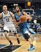 Apr 2, 2014; Minneapolis, MN, USA;  Minnesota Timberwolves guard Ricky Rubio (9) drives to the basket past Memphis Grizzlies guard Nick Calathes (12) in the third quarter at Target Center. The Wolves defeated the Grizzlies 102-88.  Mandatory Credit: Marilyn Indahl-USA TODAY Sports