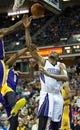 Apr 2, 2014; Sacramento, CA, USA; Los Angeles Lakers forward Nick Young (0) fouls Sacramento Kings forward Rudy Gay (8) on a shot during the third quarter at Sleep Train Arena. The Sacramento Kings defeated the Los Angeles Lakers 107-102. Mandatory Credit: Kelley L Cox-USA TODAY Sports