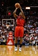Mar 31, 2014; Miami, FL, USA;  Toronto Raptors guard Kyle Lowry (7) shoots the ball in the first half of a game against the Miami Heat at American Airlines Arena. Mandatory Credit: Robert Mayer-USA TODAY Sports