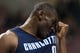 Apr 2, 2014; Philadelphia, PA, USA; Charlotte Bobcats center Bismack Biyombo (0) wipes his face during the fourth quarter against the Philadelphia 76ers at the Wells Fargo Center. The Bobcats defeated the Sixers 123-93. Mandatory Credit: Howard Smith-USA TODAY Sports