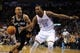 Apr 3, 2014; Oklahoma City, OK, USA; San Antonio Spurs guard Patty Mills (8) drives to the basket against Oklahoma City Thunder forward Kevin Durant (35) during the fourth quarter at Chesapeake Energy Arena. Mandatory Credit: Mark D. Smith-USA TODAY Sports