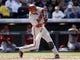 Apr 4, 2014; Denver, CO, USA; Arizona Diamondbacks third baseman Martin Prado (14) hits a single during the fourth inning against the Colorado Rockies at Coors Field. Mandatory Credit: Chris Humphreys-USA TODAY Sports