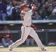 Apr 4, 2014; Denver, CO, USA; Arizona Diamondbacks left fielder Mark Trumbo (15) hits a home run during the fifth inning against the Colorado Rockies at Coors Field. Mandatory Credit: Chris Humphreys-USA TODAY Sports