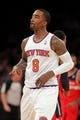 Apr 4, 2014; New York, NY, USA; New York Knicks shooting guard J.R. Smith (8) reacts after hitting a three point shot against the Washington Wizards during the first quarter of a game at Madison Square Garden. Mandatory Credit: Brad Penner-USA TODAY Sports