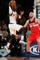 Apr 4, 2014; New York, NY, USA; New York Knicks shooting guard Iman Shumpert (21) looks to pass while defended by Washington Wizards center Marcin Gortat (4) during the first quarter of a game at Madison Square Garden. Mandatory Credit: Brad Penner-USA TODAY Sports