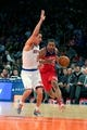 Apr 4, 2014; New York, NY, USA; Washington Wizards point guard Andre Miller (24) drives to the basket past New York Knicks point guard Pablo Prigioni (9) during the first quarter of a game at Madison Square Garden. Mandatory Credit: Brad Penner-USA TODAY Sports