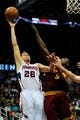 Apr 4, 2014; Atlanta, GA, USA; Atlanta Hawks guard Kyle Korver (26) shoots over Cleveland Cavaliers forward Luol Deng (9) during the second half at Philips Arena. The Hawks defeated the Cavaliers 117-98. Mandatory Credit: Dale Zanine-USA TODAY Sports