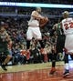 Apr 4, 2014; Chicago, IL, USA;  Chicago Bulls center Joakim Noah (13) grabs a rebound against the Milwaukee Bucks during the second half at the United Center. The Chicago Bulls defeated the Milwaukee Bucks 102-90. Mandatory Credit: David Banks-USA TODAY Sports