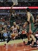 Apr 4, 2014; Chicago, IL, USA; Chicago Bulls forward Taj Gibson (22) is defended by Milwaukee Bucks forward Khris Middleton (22) during the second half at the United Center. The Chicago Bulls defeated the Milwaukee Bucks 102-90. Mandatory Credit: David Banks-USA TODAY Sports