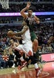 Apr 4, 2014; Chicago, IL, USA;  Chicago Bulls guard Jimmy Butler (21) is defended by Milwaukee Bucks center Zaza Pachulia (27) during the second half at the United Center. The Chicago Bulls defeated the Milwaukee Bucks 102-90. Mandatory Credit: David Banks-USA TODAY Sports
