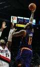 Apr 4, 2014; Portland, OR, USA; Phoenix Suns forward P.J. Tucker (17) puts up a shot on Portland Trail Blazers guard Mo Williams (25) during the first quarter of the game at Moda Center. Mandatory Credit: Steve Dykes-USA TODAY Sports