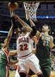 Apr 4, 2014; Chicago, IL, USA; Chicago Bulls forward Taj Gibson (22) is defended by Milwaukee Bucks center Zaza Pachulia (27) during the second half at the United Center. The Chicago Bulls defeated the Milwaukee Bucks 102-90. Mandatory Credit: David Banks-USA TODAY Sports