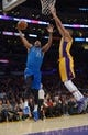 Apr 4, 2014; Los Angeles, CA, USA; Dallas Mavericks guard Wayne Ellington (21) is defended by Los Angeles Lakers forward Wesley Johnson (11) at Staples Center. Mandatory Credit: Kirby Lee-USA TODAY Sports