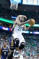 Apr 4, 2014; Salt Lake City, UT, USA; Utah Jazz guard Ian Clark (21) goes to the basket during the second half against the New Orleans Pelicans at EnergySolutions Arena. The Jazz won 100-96. Mandatory Credit: Russ Isabella-USA TODAY Sports