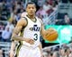 Apr 4, 2014; Salt Lake City, UT, USA; Utah Jazz guard Trey Burke (3) dribbles up the court during the second half against the New Orleans Pelicans at EnergySolutions Arena. The Jazz won 100-96. Mandatory Credit: Russ Isabella-USA TODAY Sports