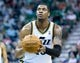 Apr 4, 2014; Salt Lake City, UT, USA; Utah Jazz center Derrick Favors (15) shoots a free throw during the second half against the New Orleans Pelicans at EnergySolutions Arena. The Jazz won 100-96. Mandatory Credit: Russ Isabella-USA TODAY Sports