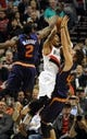 Apr 4, 2014; Portland, OR, USA; Portland Trail Blazers guard Damian Lillard (0) finds his path to the basket blocked by Phoenix Suns guard Eric Bledsoe (2) and forward Shavlik Randolph (43) during the fourth quarter of the game against the Phoenix Suns at Moda Center. the Suns won the game 109-93. Mandatory Credit: Steve Dykes-USA TODAY Sports