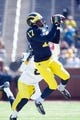 Apr 5, 2014; Ann Arbor, MI, USA; Michigan Wolverines wide receiver Freddy Canteen (17) catches during the Spring Game at Michigan Stadium. Mandatory Credit: Tim Fuller-USA TODAY Sports