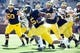 Apr 5, 2014; Ann Arbor, MI, USA; Michigan Wolverines running back Justice Hayes (5) runs with the ball during the Spring Game at Michigan Stadium. Mandatory Credit: Tim Fuller-USA TODAY Sports