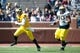 Apr 5, 2014; Ann Arbor, MI, USA; Michigan Wolverines quarterback Shane Morris (7) runs with the ball in front of defensive tackle Bryan Mone (90) during the Spring Game at Michigan Stadium. Mandatory Credit: Tim Fuller-USA TODAY Sports