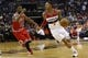 Apr 5, 2014; Washington, DC, USA; Washington Wizards guard Bradley Beal (3) dribbles the ball as Chicago Bulls guard Jimmy Butler (21) defends in the first quarter at Verizon Center. Mandatory Credit: Geoff Burke-USA TODAY Sports