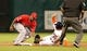 Apr 5, 2014; Houston, TX, USA; Houston Astros second baseman Jose Altuve (27) steals second base ahead of the tag from Los Angeles Angels shortstop Erick Aybar (2) during the first inning at Minute Maid Park. Mandatory Credit: Andrew Richardson-USA TODAY Sports