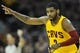 Apr 5, 2014; Cleveland, OH, USA; Cleveland Cavaliers guard Kyrie Irving (2) celebrates a three-point basket in the first quarter against the Charlotte Bobcats at Quicken Loans Arena. Mandatory Credit: David Richard-USA TODAY Sports