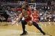 Apr 5, 2014; Washington, DC, USA; Chicago Bulls guard Kirk Hinrich (12) dribbles the ball as Washington Wizards guard John Wall (2) defends in the fourth quarter at Verizon Center. The Bulls won 96-78. Mandatory Credit: Geoff Burke-USA TODAY Sports
