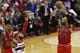 Apr 5, 2014; Washington, DC, USA; Chicago Bulls forward Taj Gibson (22) shoots the ball over Washington Wizards forward Drew Gooden (90) in the third quarter at Verizon Center. The Bulls won 96-78. Mandatory Credit: Geoff Burke-USA TODAY Sports