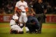 Apr 5, 2014; Houston, TX, USA; Houston Astros catcher Carlos Corporan (22) is inspected by a team trainer during the fourth inning against the Los Angeles Angels at Minute Maid Park. Mandatory Credit: Andrew Richardson-USA TODAY Sports