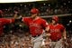 Apr 5, 2014; Houston, TX, USA; Los Angeles Angels left fielder Josh Hamilton (32) high-fives second baseman Howie Kendrick (47) after hitting a three-run home run during the fifth inning against the Houston Astros at Minute Maid Park. Mandatory Credit: Andrew Richardson-USA TODAY Sports